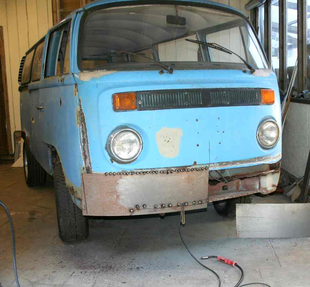 With plenty of steel in the corners, new steel panels are attached to Kombi van VW